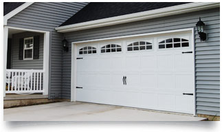 Carriage House Stamped Garage Doors in Denver - Don's Garage Doors