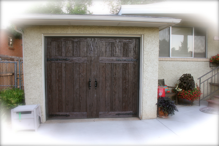Faux wood garage door sales and installation in englewood for Faux wood garage door